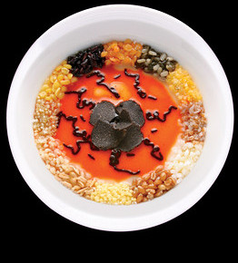 Twelve varieties of grains with black-truffle shavings in a curry-accented sauce