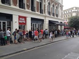 Queue snaking around Five Guys Covent Garden